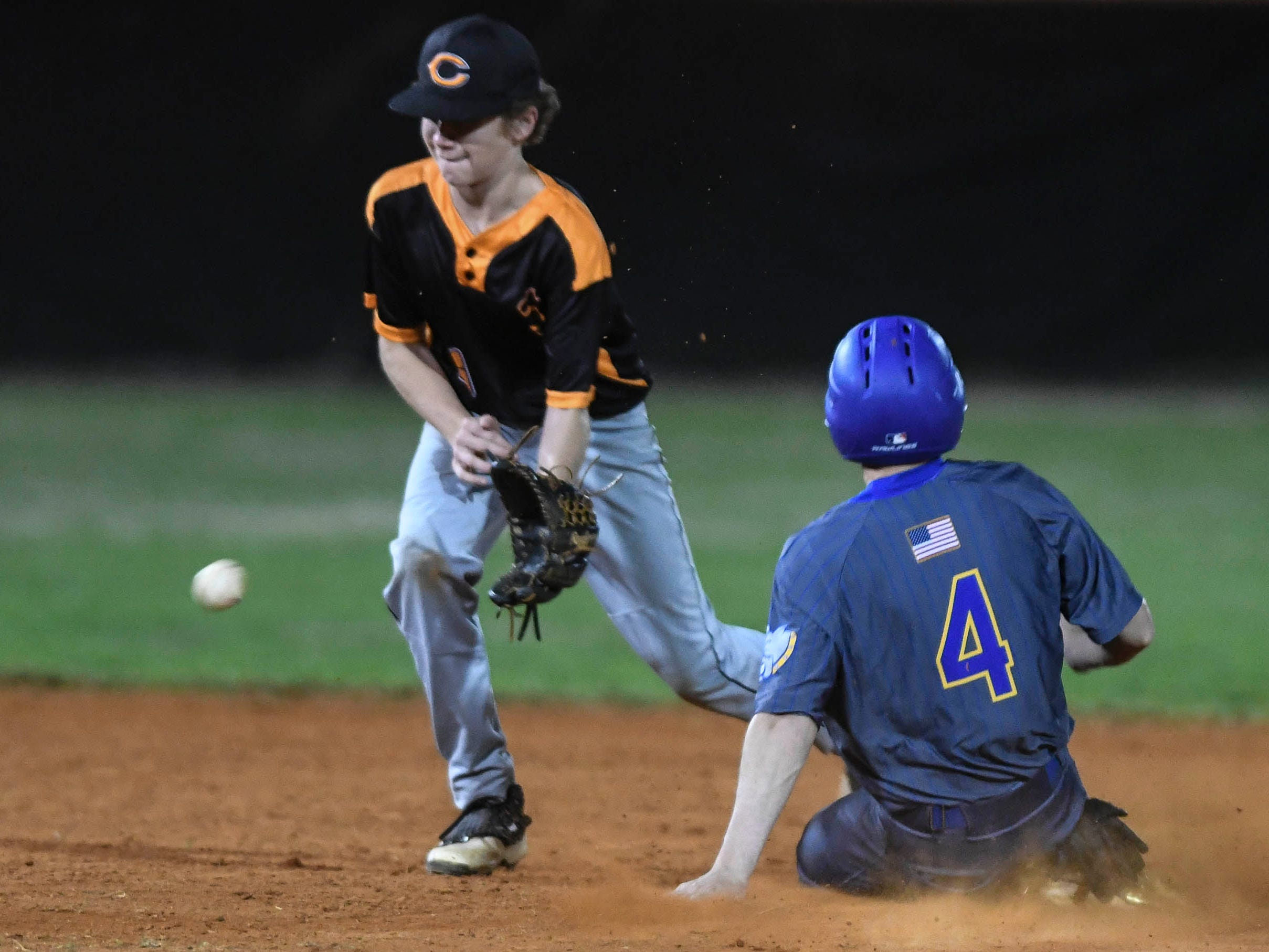 Titusville's Trey Felker makes it to second base before cocoa's Cade Davidson can make the tag during Friday's game.