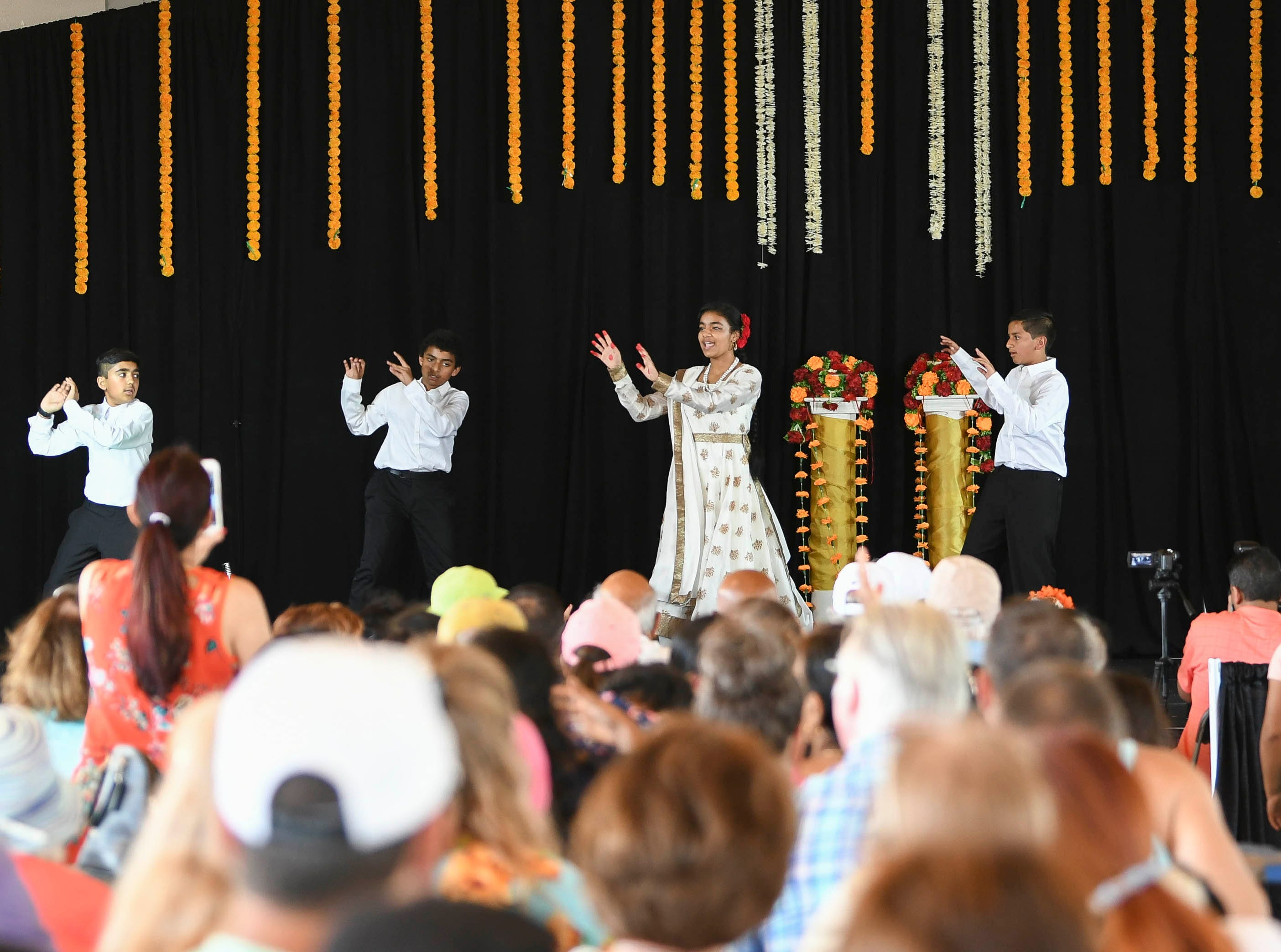 Dancers perform on stage for the crowd during Indiafest Saturday at Wickham Park's main pavilion.