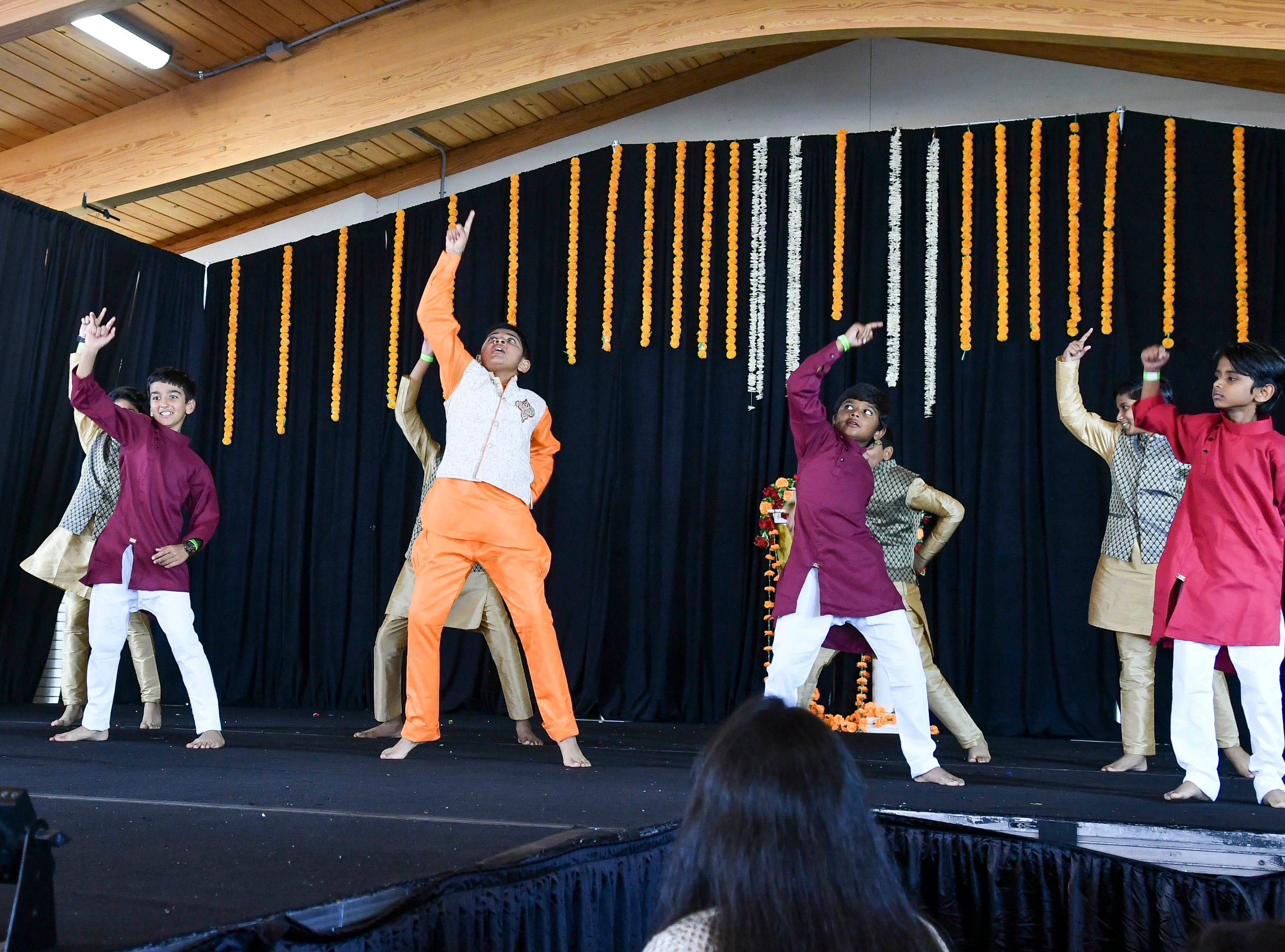 A group perform for the crowd during Indiafest Saturday at Wickham Park's main pavilion.