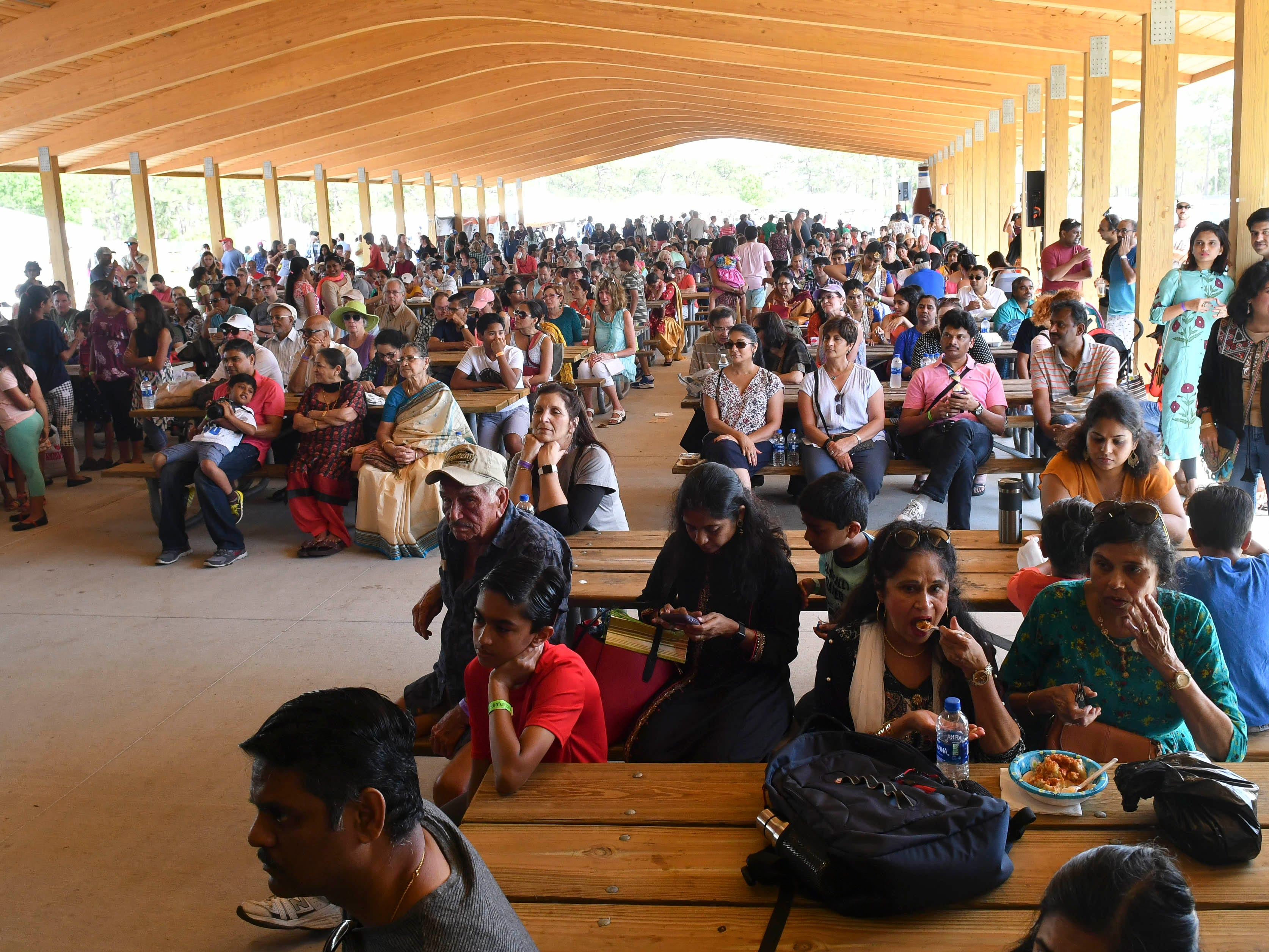Locals enjoy the food dancing, crafts and culture of Indiafest at Wickham Park's main pavilion.