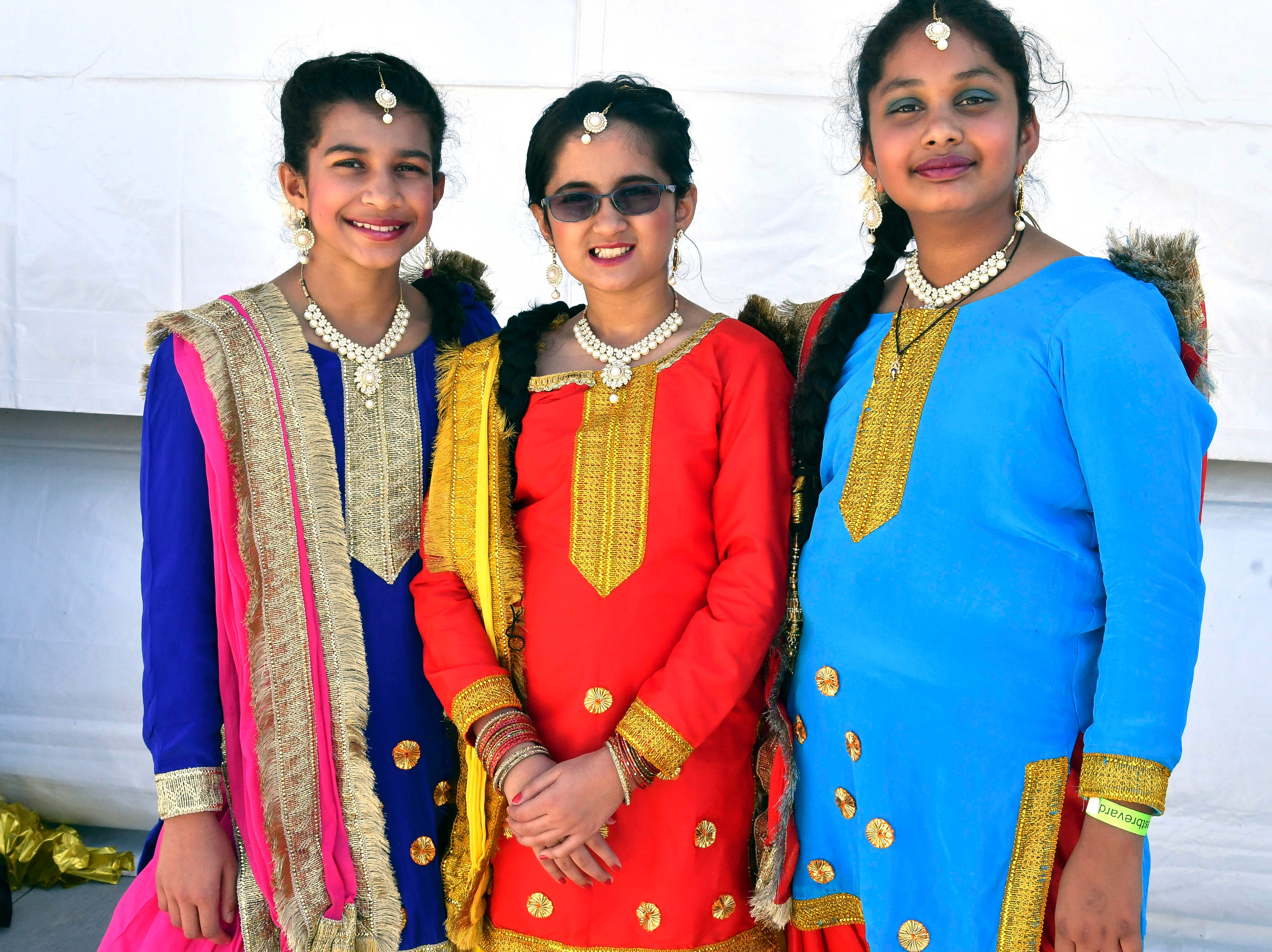 Three members of Punjabi Kudiyan pose for pictures before going on stage to perform at Indiafest Saturday. Indiafest continues Sunday 11-5 at Wickham Park's main pavilion.