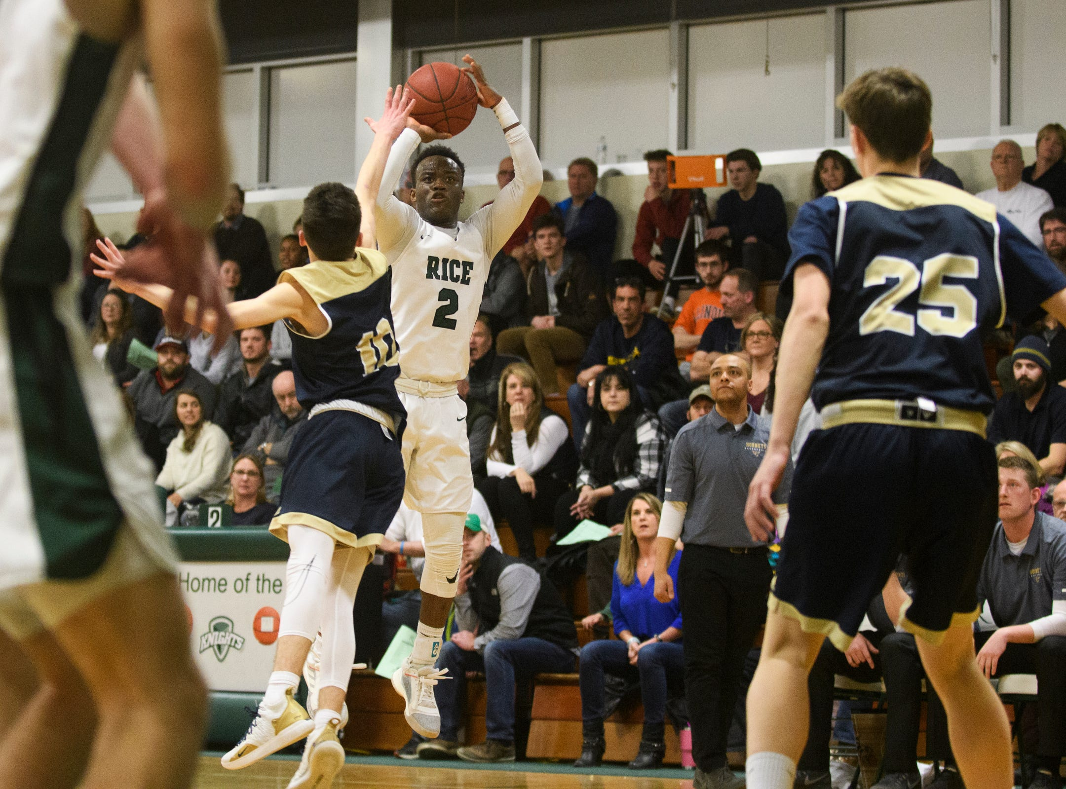 Rice's Michel Ndayishimiye (2) shoots the ball during the boys quarterfinal basketball game between the Essex Hornets and the Rice Green Knights at Rice Memorial High School on Friday night March 8, 2019 in South Burlington, Vermont.