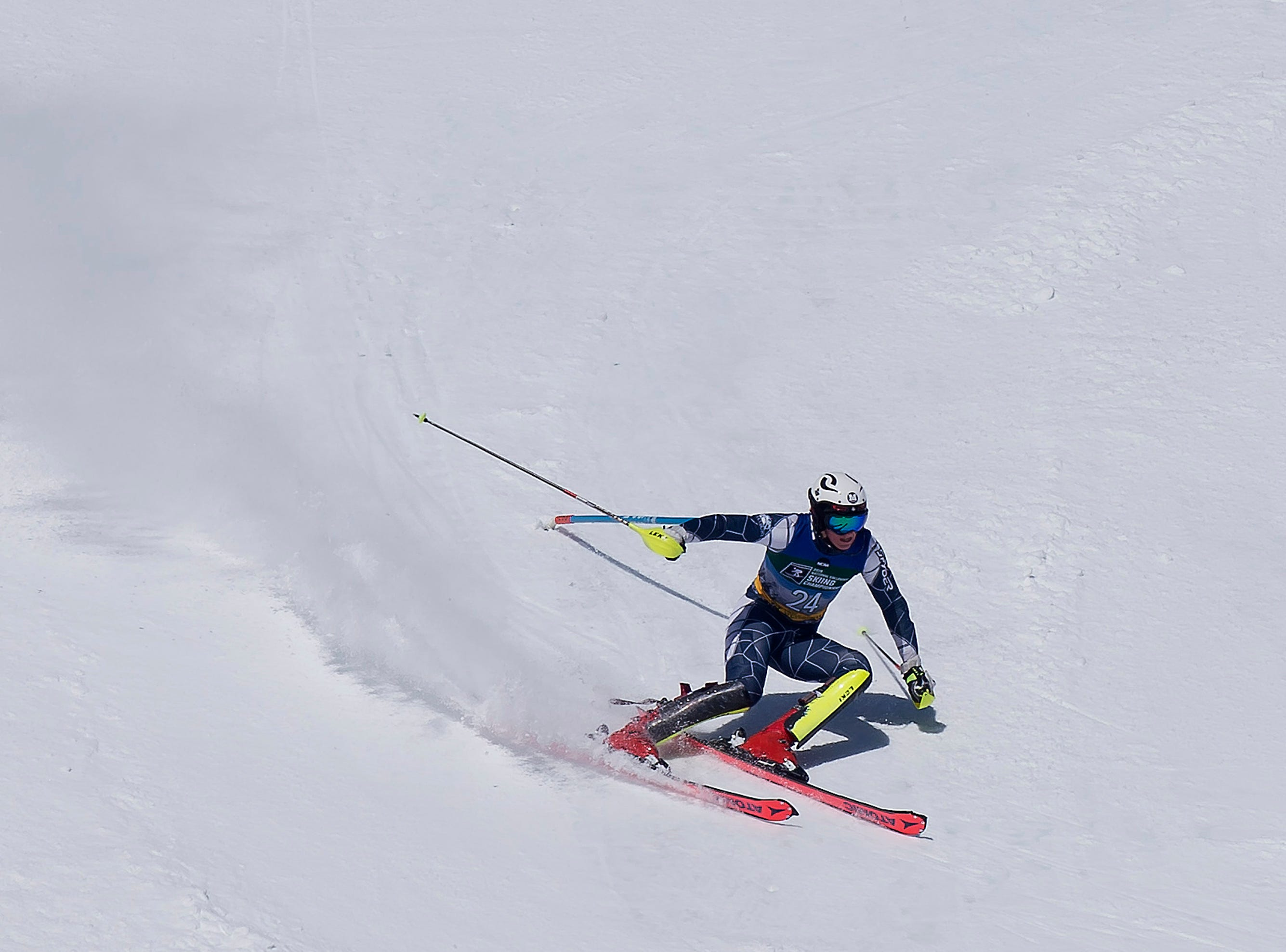 Middlebury's Justin Aiker carves a turn during the NCAA slalom championships on Saturday at Stowe Mountain Resort.