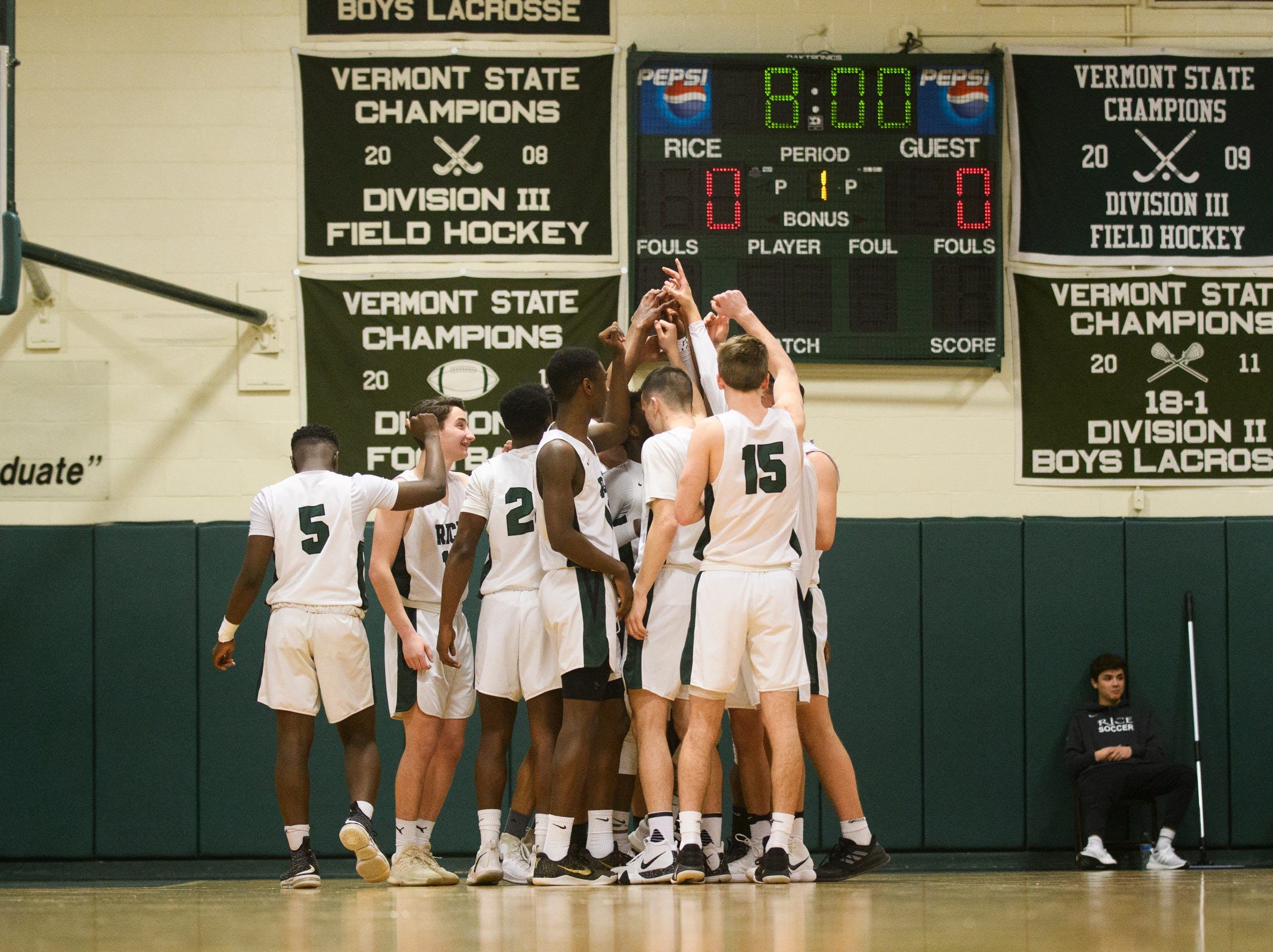 Rice huddles together during the boys quarterfinal basketball game between the Essex Hornets and the Rice Green Knights at Rice Memorial High School on Friday night March 8, 2019 in South Burlington, Vermont.