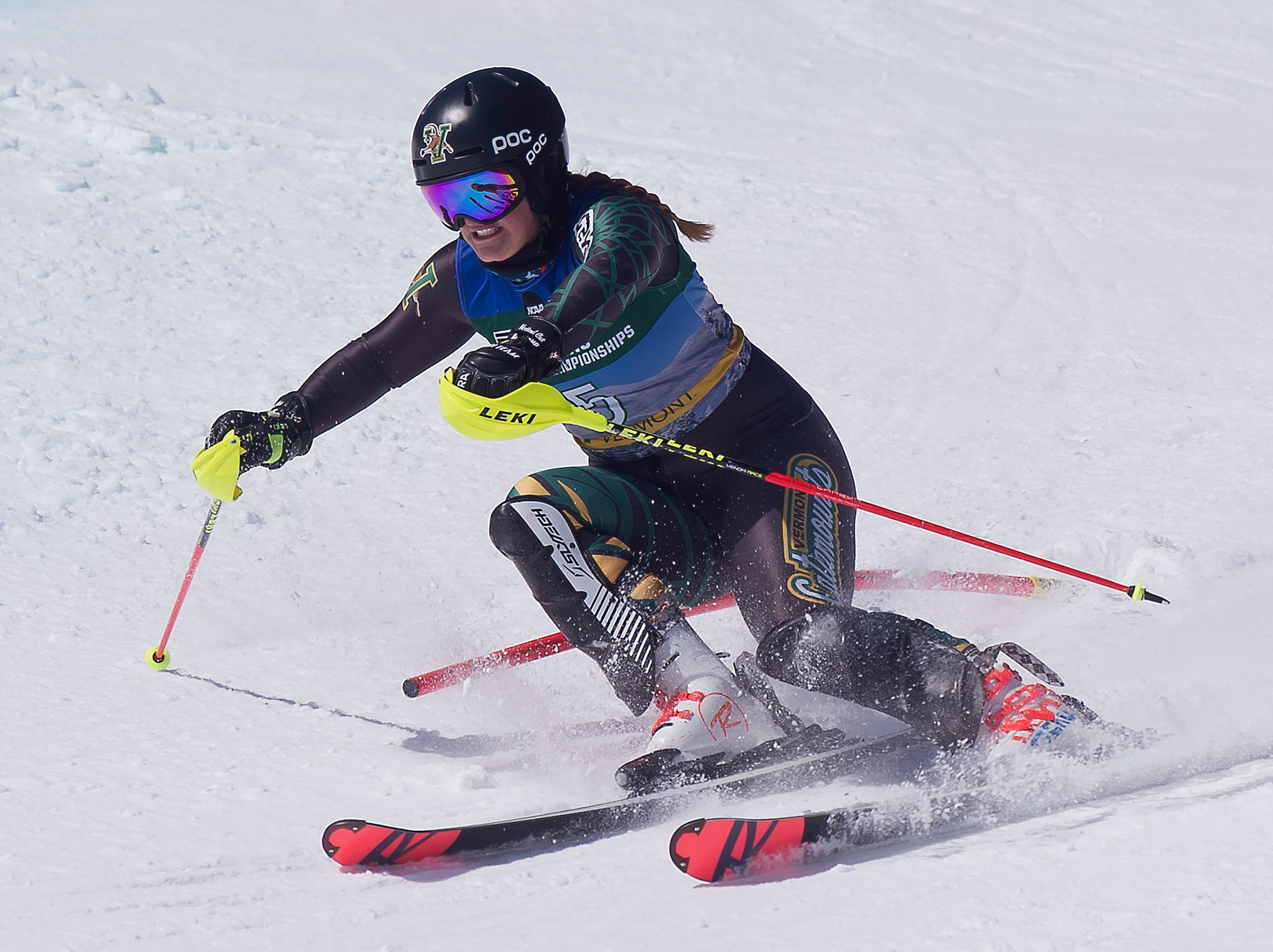 Vermont's Paula Moltzan clears a gate on the second run at the NCAA slalom championships on Saturday at Stowe Mountain Resort.