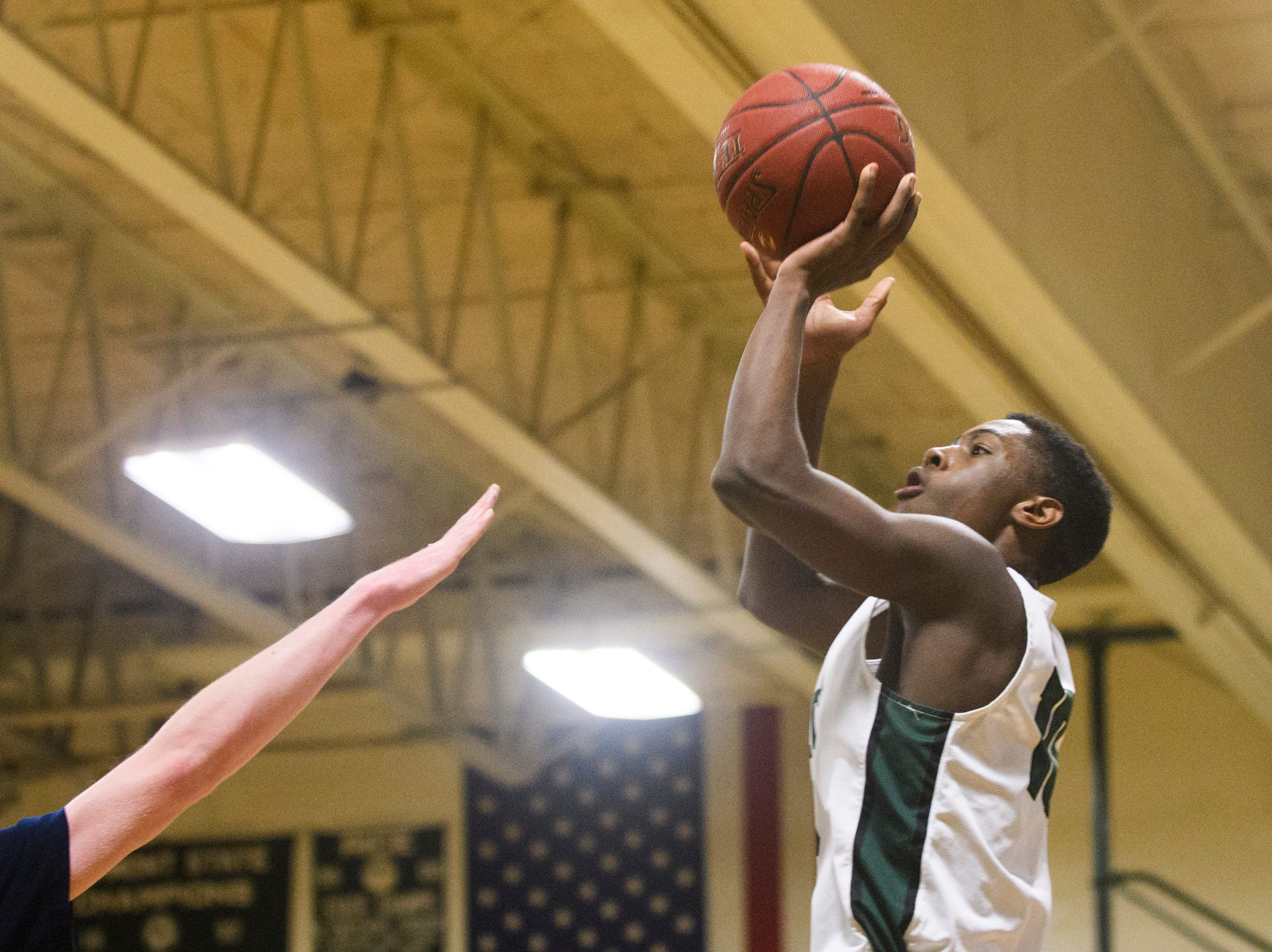 Rice's Leo Chaikin (10) shoots the ball during the boys quarterfinal basketball game between the Essex Hornets and the Rice Green Knights at Rice Memorial High School on Friday night March 8, 2019 in South Burlington, Vermont.