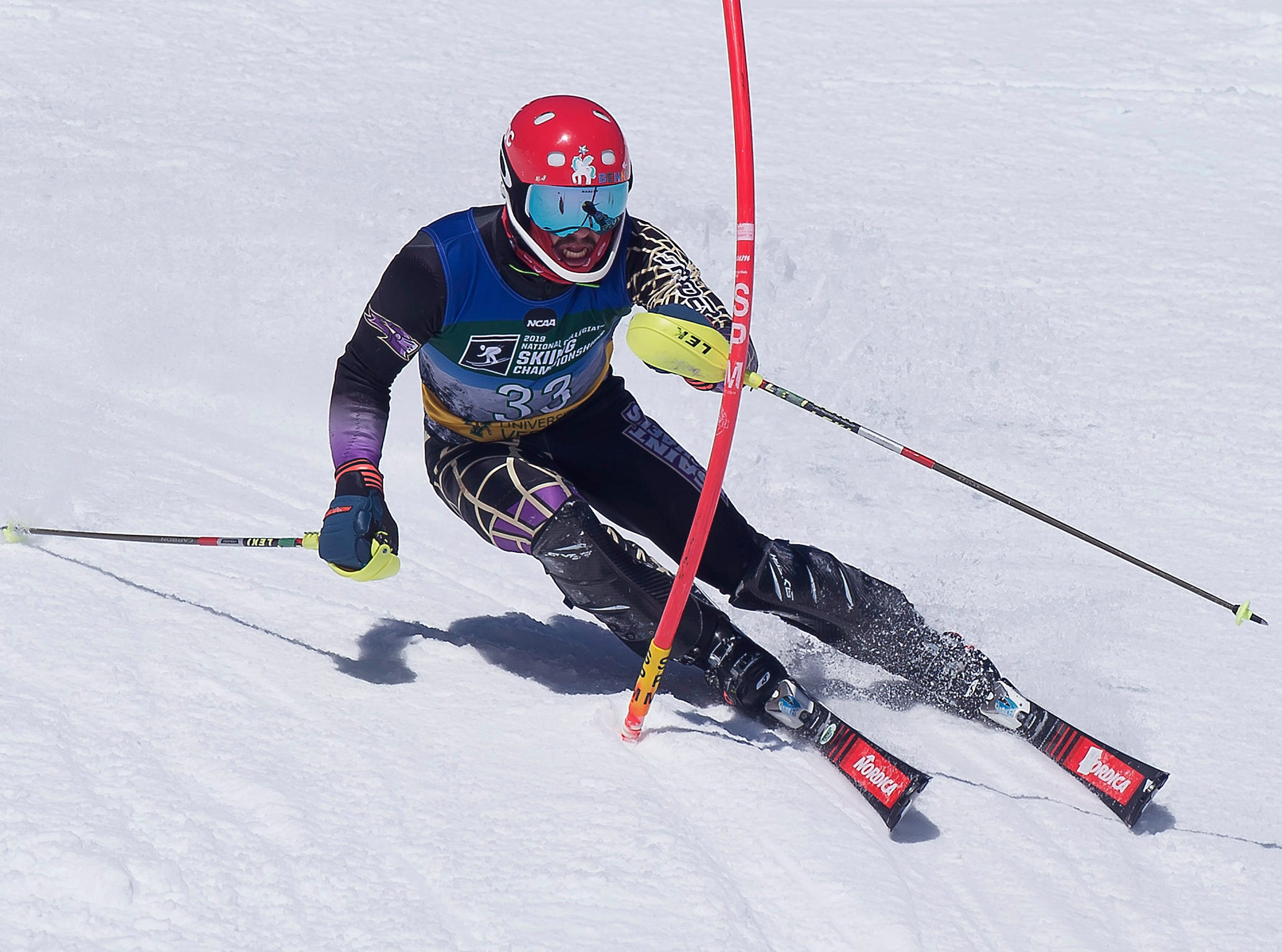 St. Michael's College skier Benjamin Throm clears a gate at the NCAA slalom championships on Saturday at Stowe Mountain Resort.