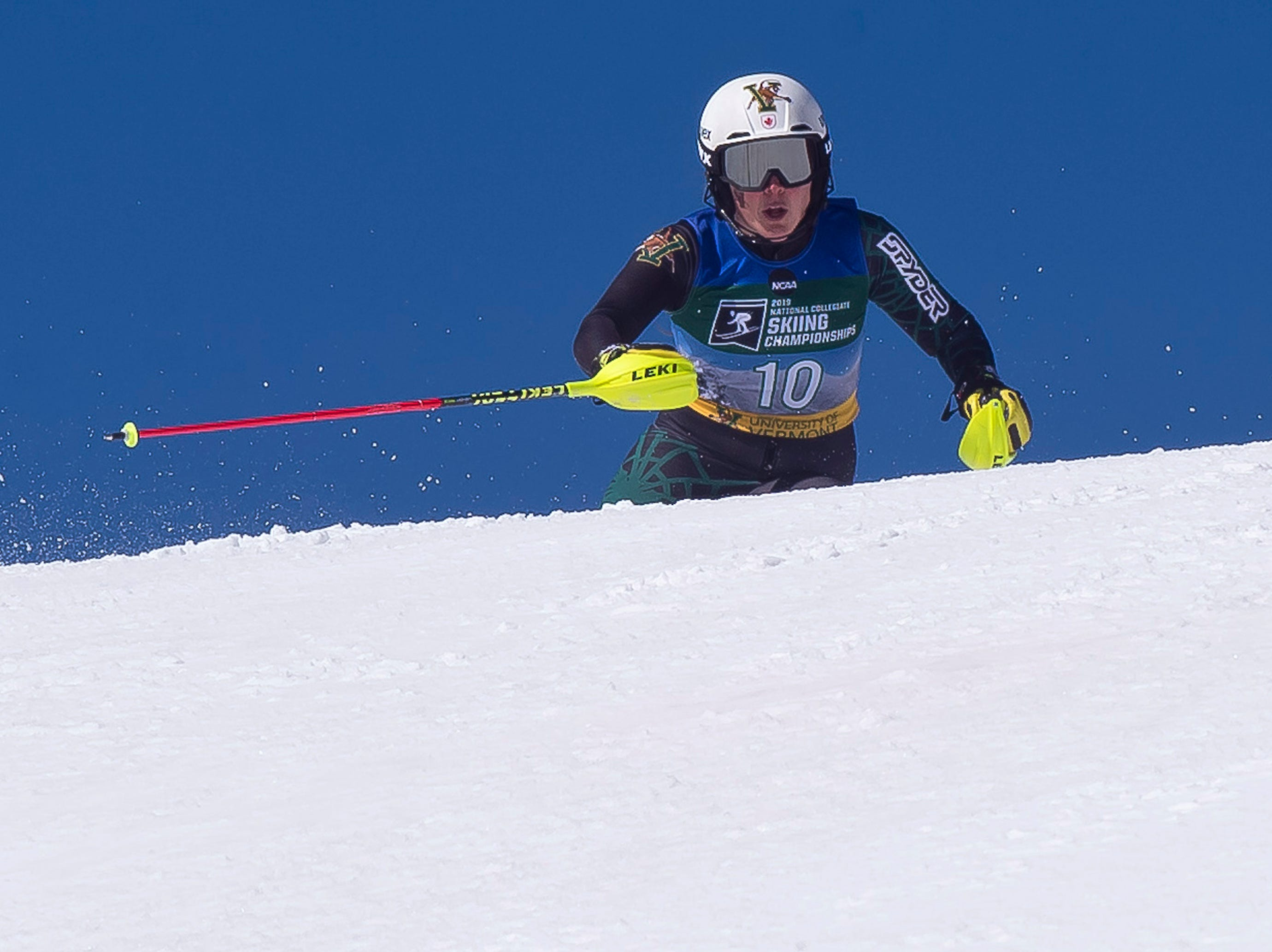 Vermont's Laurence St. Germain crests the final ridge at the NCAA slalom championships on Saturday at Stowe Mountain Resort.