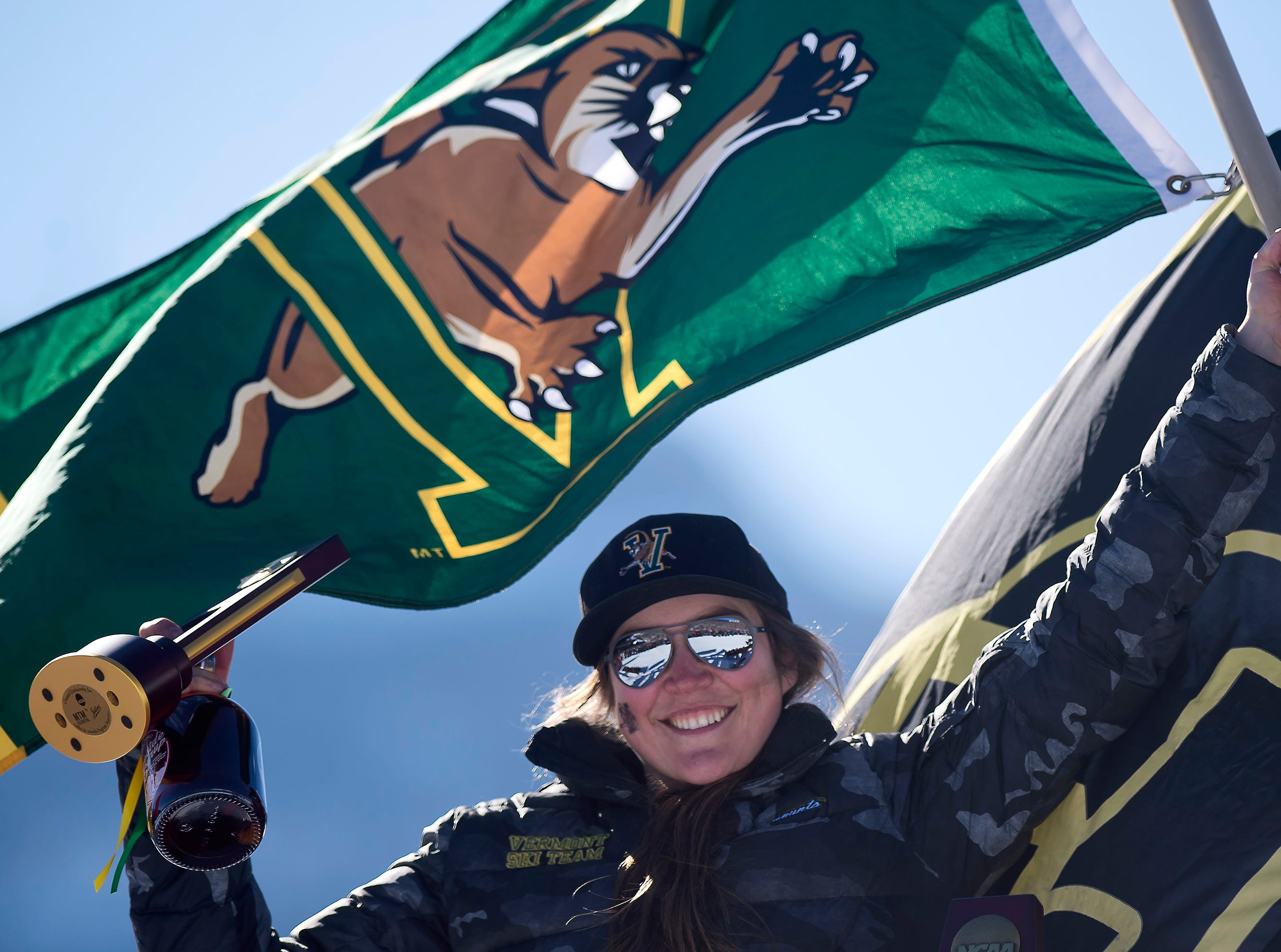 Vermont's Laurence St. Germain tops the podium after winning the NCAA women's slalom championship on Saturday at Stowe Mountain Resort.
