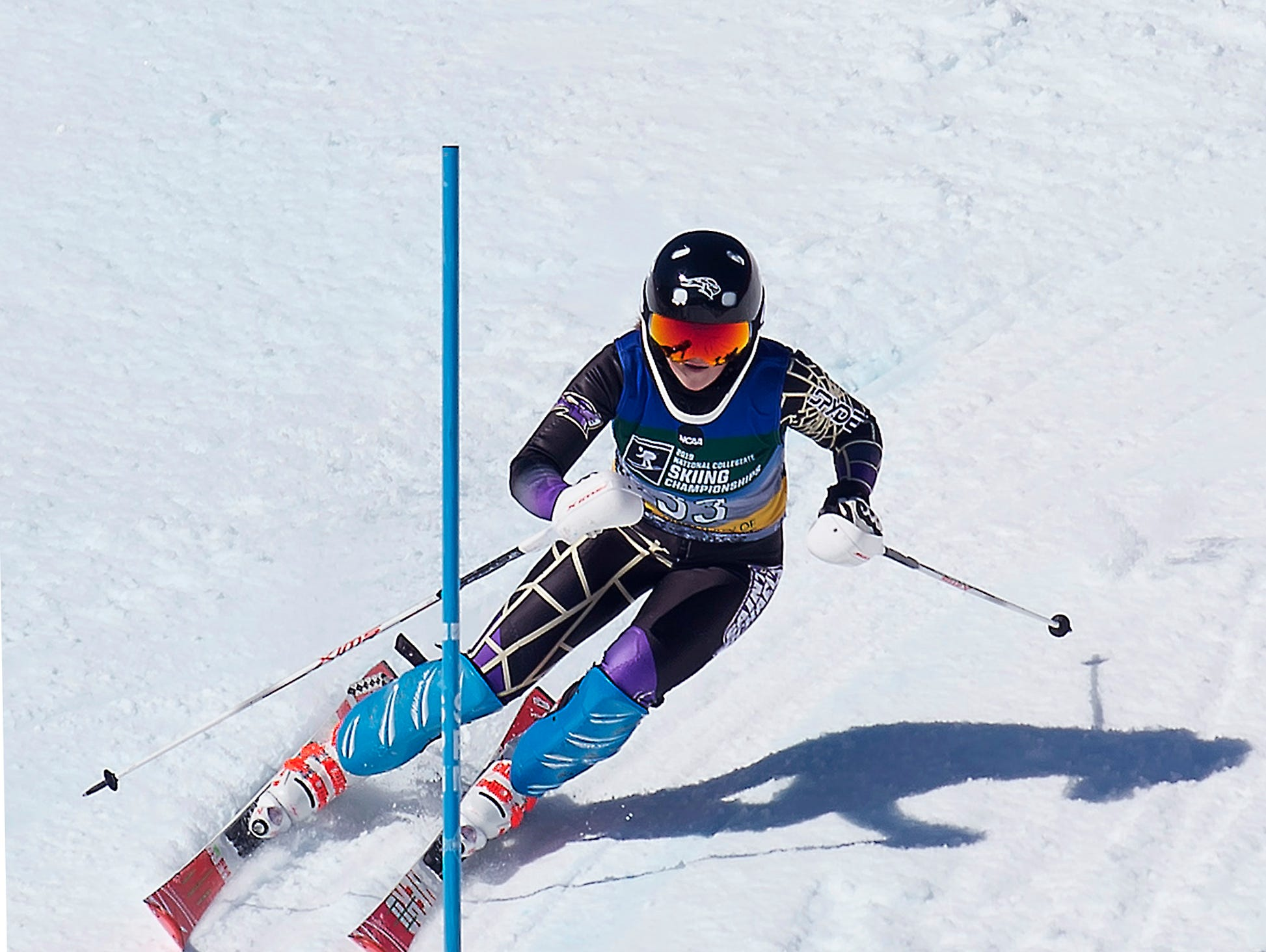 St. MIchael's College skier Anna Willassen races to the finish line at the NCAA slalom championships on Saturday at Stowe Mountain Resort.