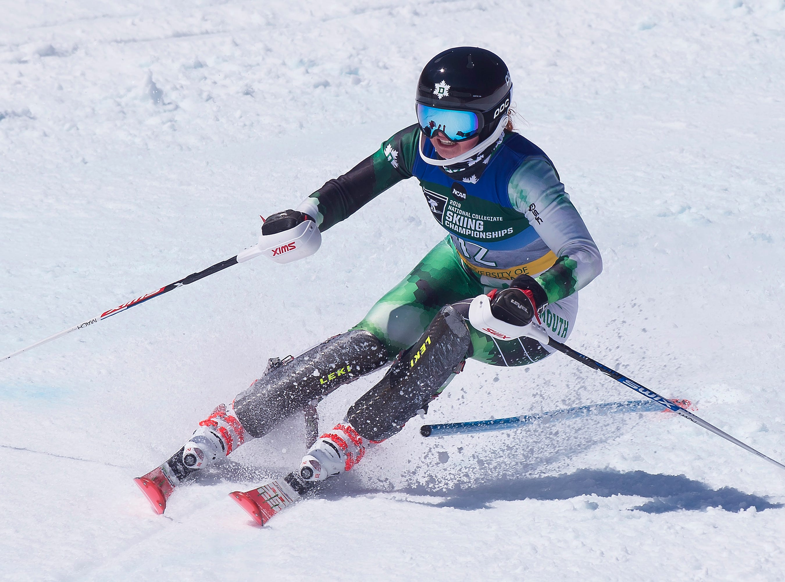 Dartmouth's Stephanie Currie turns past a gate at the NCAA slalom championships on Saturday at Stowe Mountain Resort.