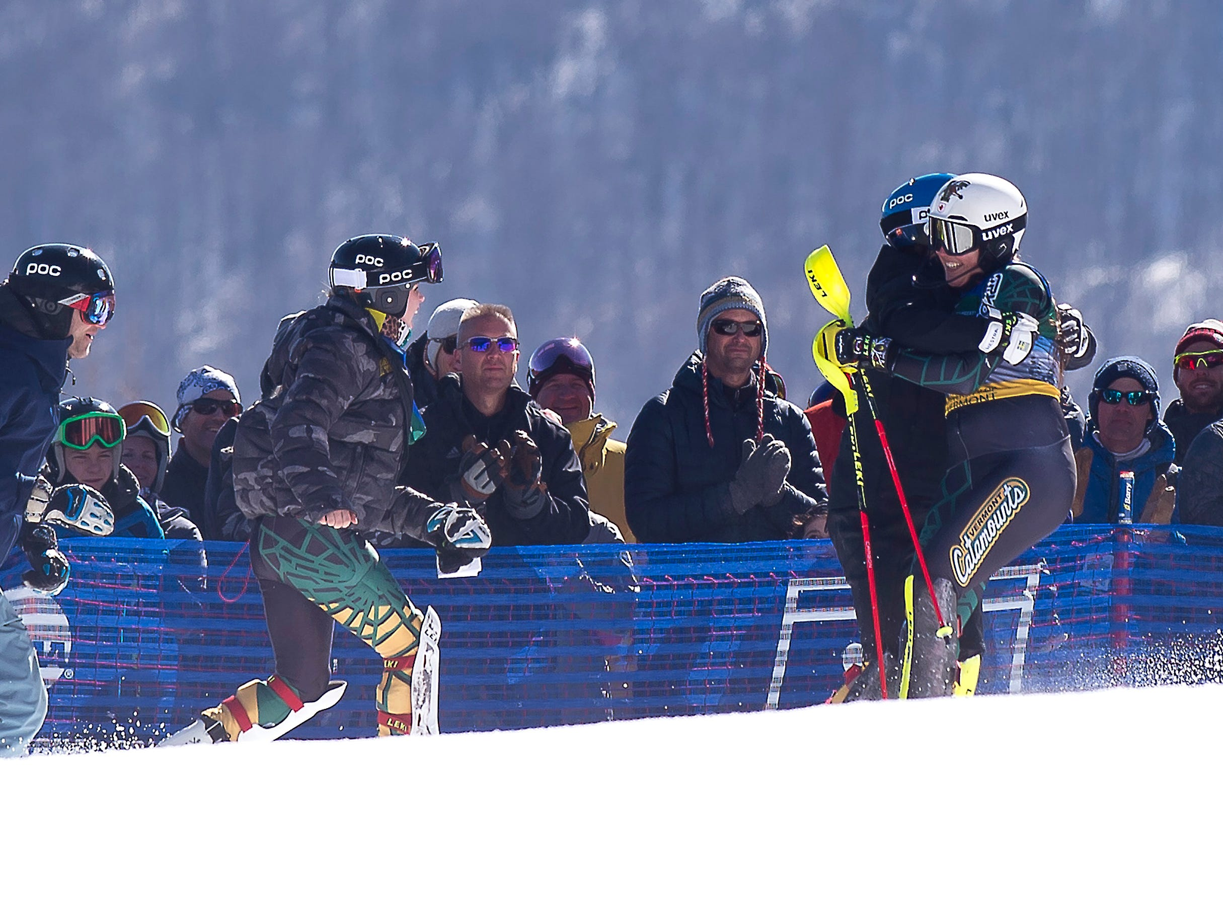 The University of Vermont's Laurence St. Germain is mobbed by teammates after winning the slalom title at the NCAA championships on Saturday at Stowe Mountain Resort.
