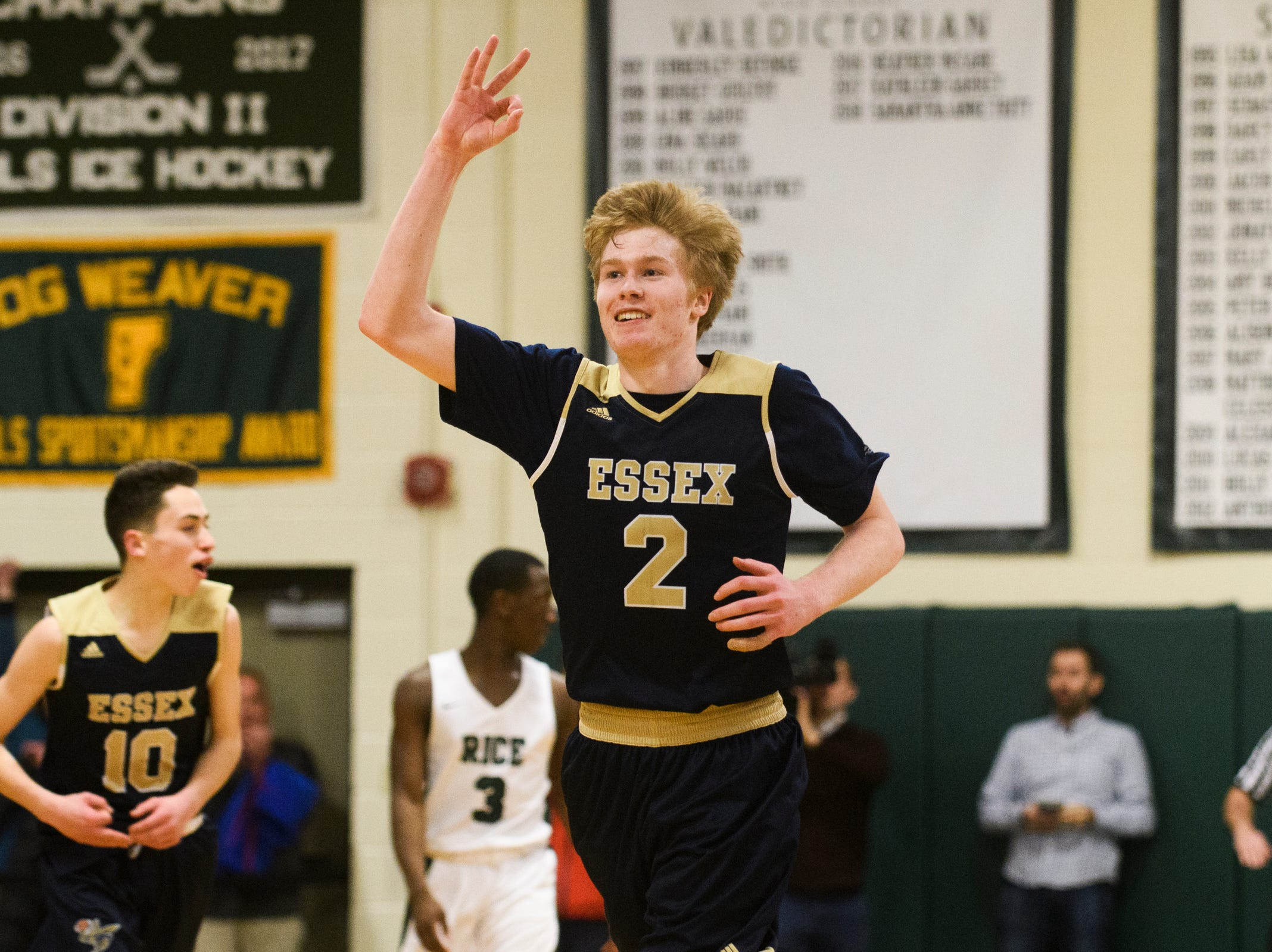 Essex's Stephen Astor (2) celebrates after making a 3-pointer during the boys  quarterfinal basketball game between the Essex Hornets and the Rice Green Knights at Rice Memorial High School on Friday night March 8, 2019 in South Burlington, Vermont.