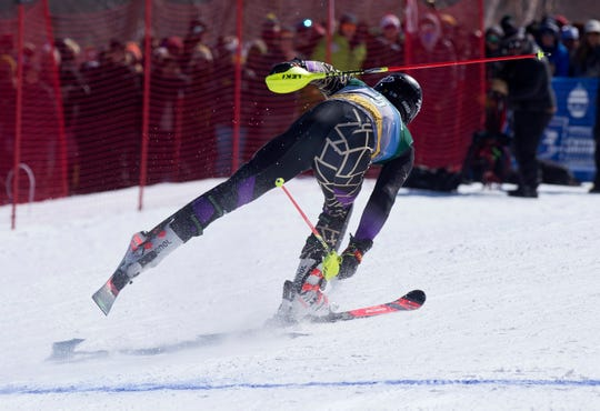 St. Michael's College skier Guillaume Grand crosses the finish line for his second run at the NCAA slalom championships on Saturday at Stowe Mountain Resort.