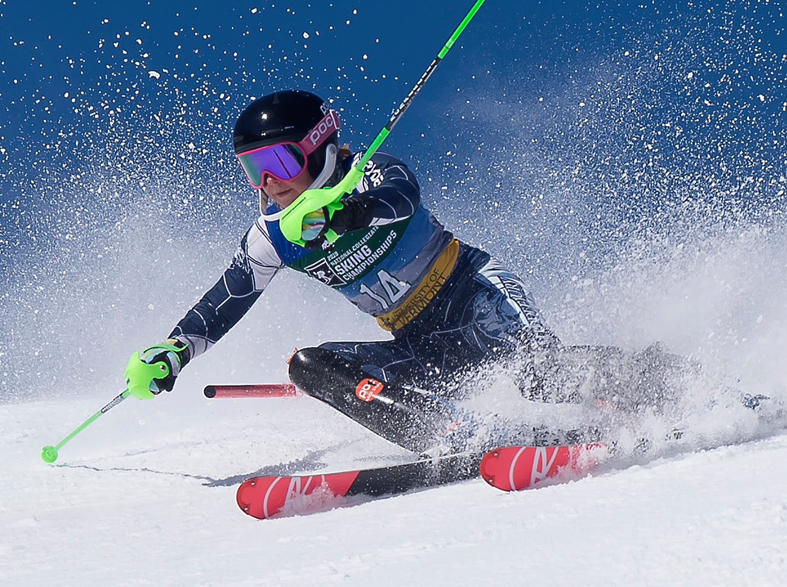 Middlebury's Lucia Bailey carves past a gate at the NCAA slalom championships on Saturday at Stowe Mountain Resort.