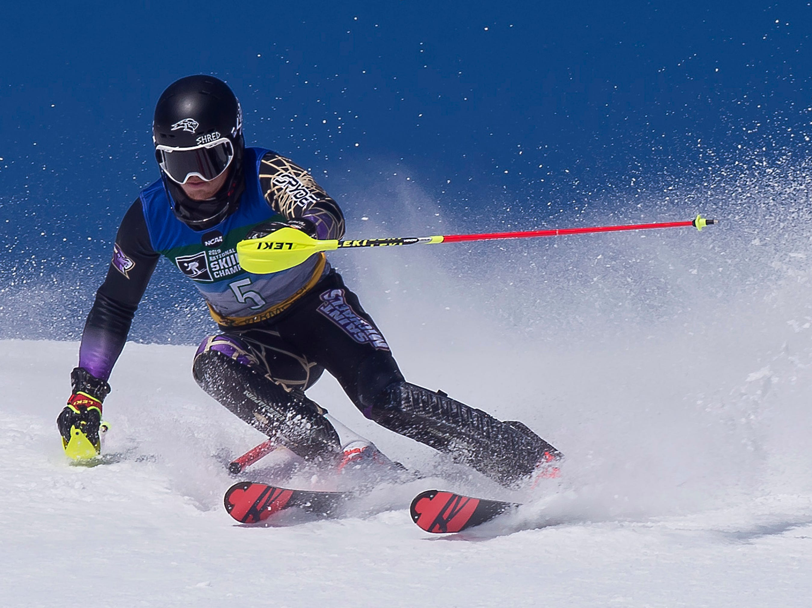 St. Michael's College skier Guillaume Grand clears a gate at the NCAA slalom championships on Saturday at Stowe Mountain Resort.