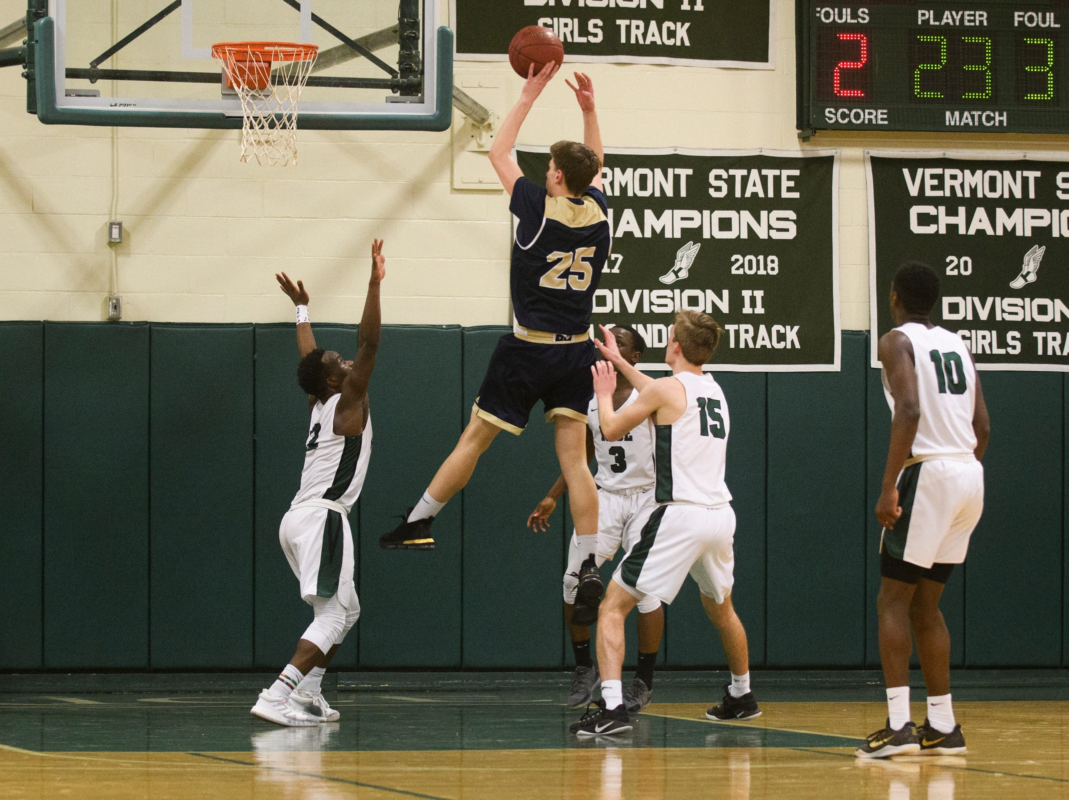 Essex's Mitchell Moffatt (25) leaps to take a shot during the boys quarterfinal basketball game between the Essex Hornets and the Rice Green Knights at Rice Memorial High School on Friday night March 8, 2019 in South Burlington, Vermont.