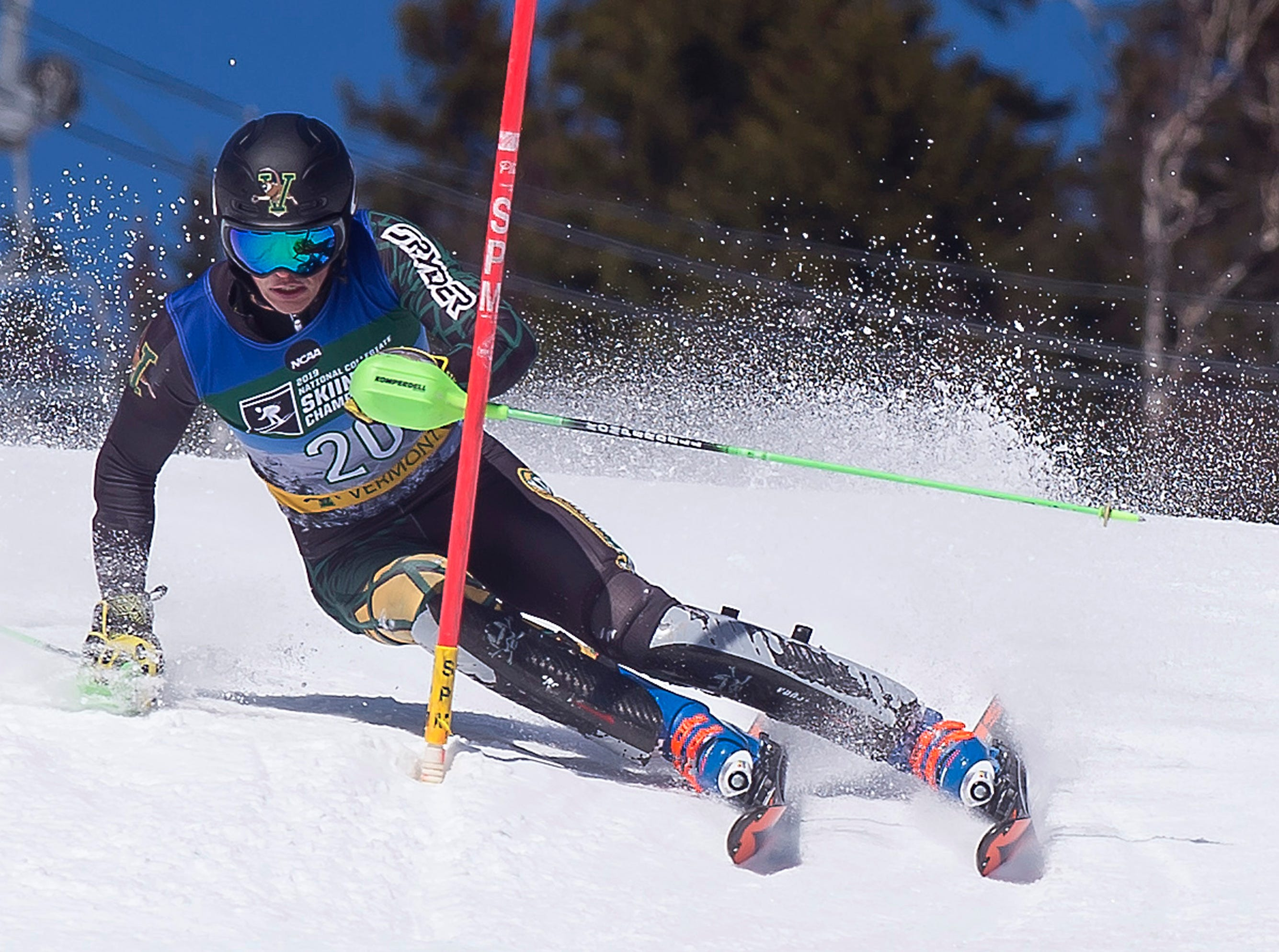 Vermont's Max Roeisland charges down the hill for his second run at the NCAA slalom championships on Saturday at Stowe Mountain Resort.
