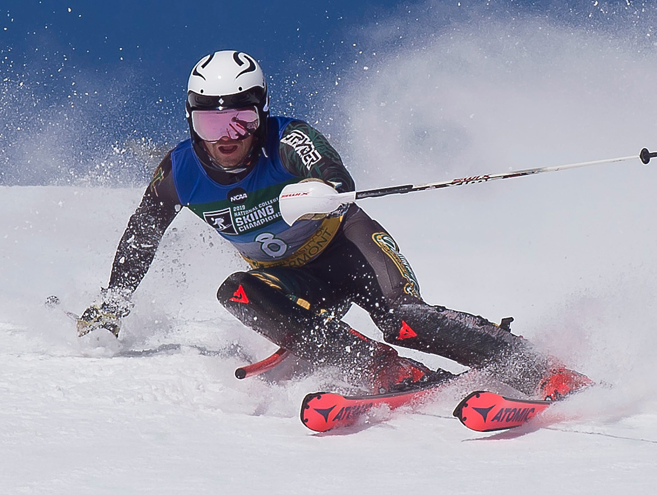 The University of Vermont's Patrick McConville clears a gate on his second run at the NCAA slalom championships on Saturday at Stowe Mountain Resort.