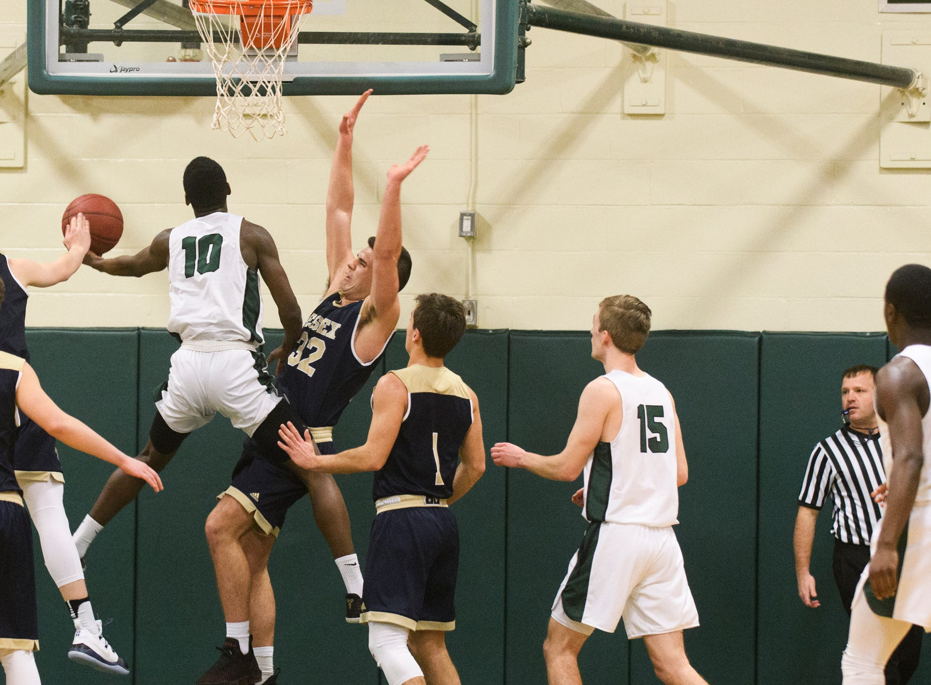 Rice's Leo Chaikin (10) leaps for a lay up during the boys quarterfinal basketball game between the Essex Hornets and the Rice Green Knights at Rice Memorial High School on Friday night March 8, 2019 in South Burlington, Vermont.