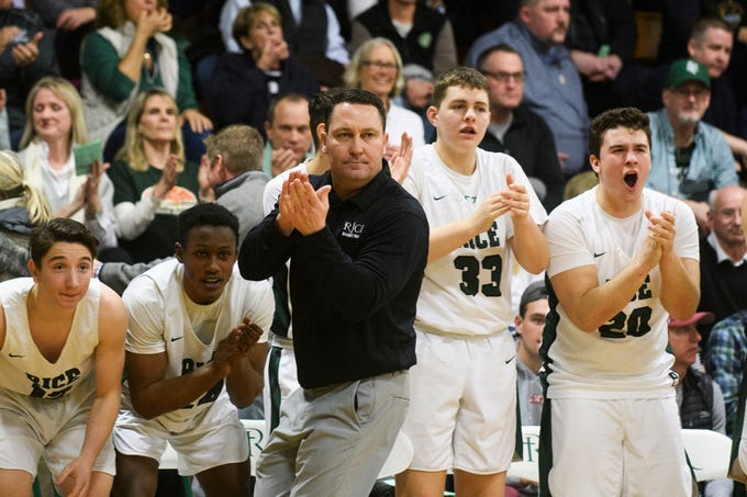 Rice head coach Paul Pecor cheers for the team during the boys quarterfinal basketball game between the Essex Hornets and the Rice Green Knights at Rice Memorial High School on Friday night March 8, 2019 in South Burlington, Vermont.