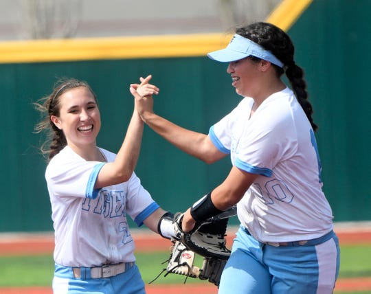 Carroll's Linzee Leal and Rhea-Ann Avalos celebrate after a play against Veterans Memorial in a softball game, Thursday, March 7, 2019, at Cabaniss Softball Field.