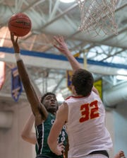 Camden Catholic's Babatunde Ajike tries to shoot over Bergen Catholic's Zach Freemantle during a 78-61 loss in the Non-Public A final on Saturday at Toms River North.