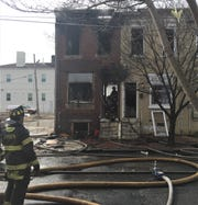 Camden firefighters at the scene of a house fire on the 800 block of Line Street, Friday.