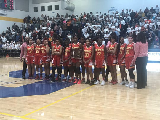 Purcell Marian girls basketball team poses with the regional runner-up trophy after falling to Waynesville, 39-35, in the regional title game, Saturday March 9, 2019 at Springfield High School.