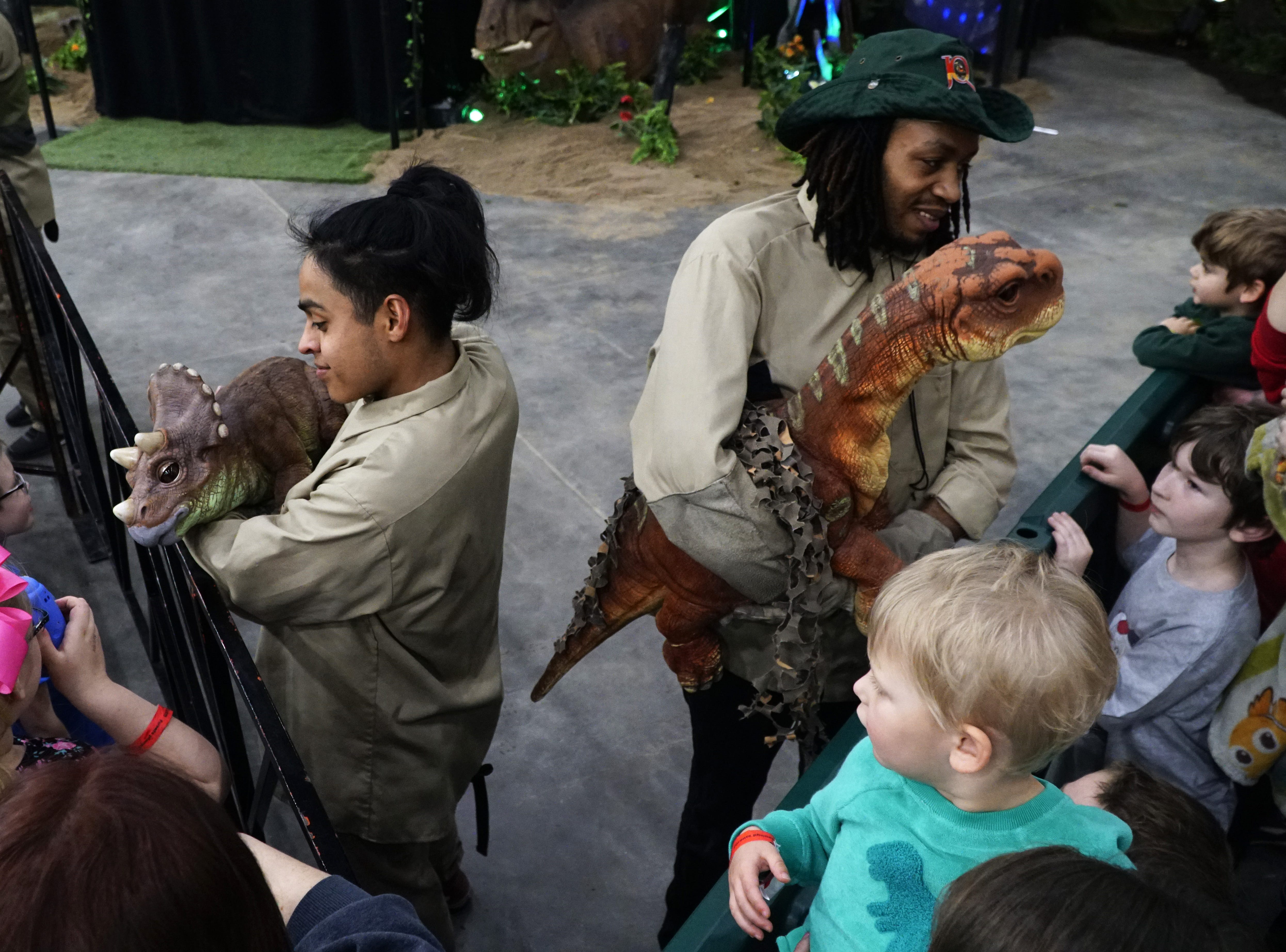 """""""Dinosaur caretakers"""" Ricky Rodriguez and Bobby Arnold use puppetry to make """"Trixi"""" the triceratops and """"Cammy"""" the camarasaurus come alive at Jurassic Quest, March 9, 2019."""