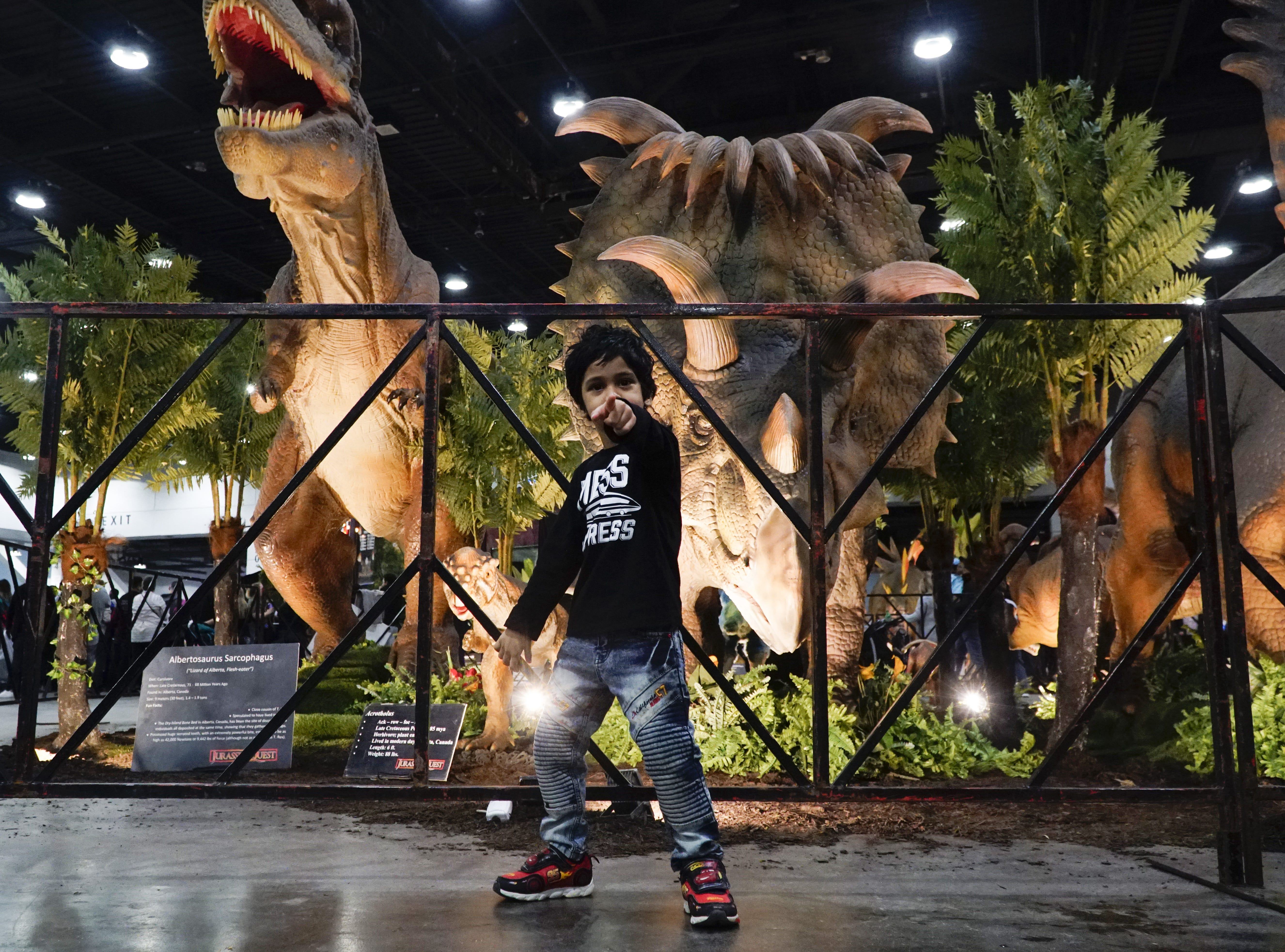 Bhavya Jain, age three, names dinosaurs with his father at Jurassic Quest, March 9, 2019.