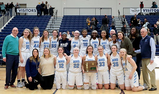 Mount Notre Dame holds their trophy after defeating Centerville in their Division I regional final at Trent Arena in Kettering Saturday, March 9, 2019.
