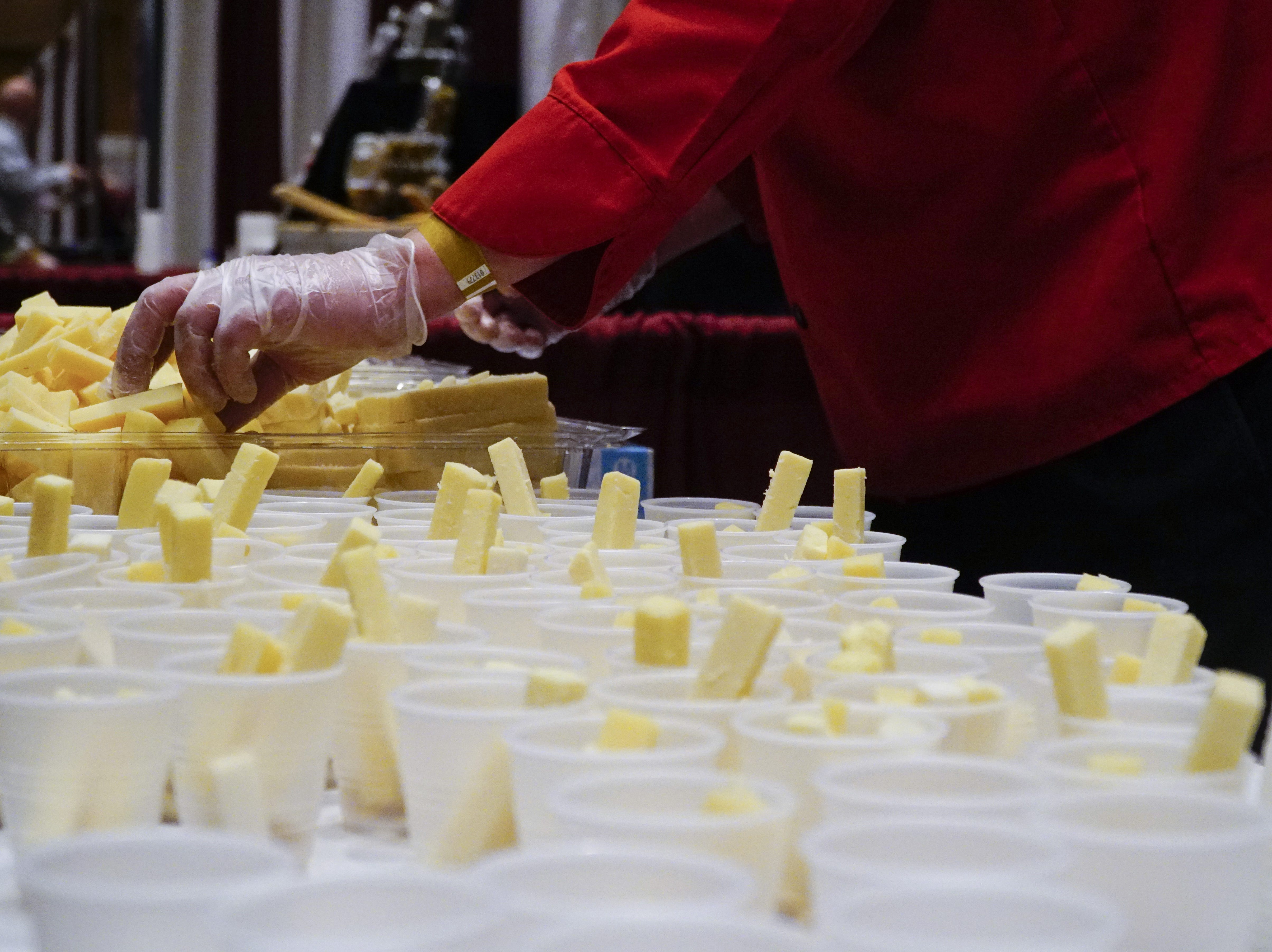 Gouda samples are prepped at Murray's Cheese at The Cincinnati International Wine Festival, March 9, 2019.