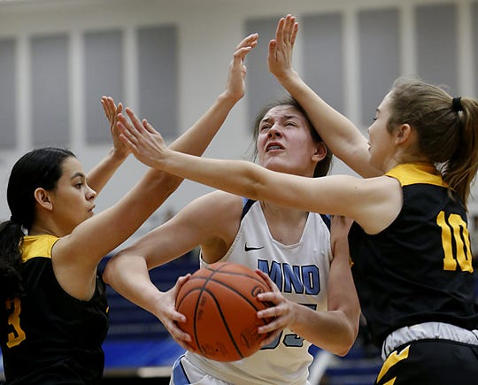 Mount Notre Dame's Julia Hoefling is double teamed by Centerville's Amy Velasco and Emma Stanley during their Division I regional final at Trent Arena in Kettering Saturday, March 9, 2019.