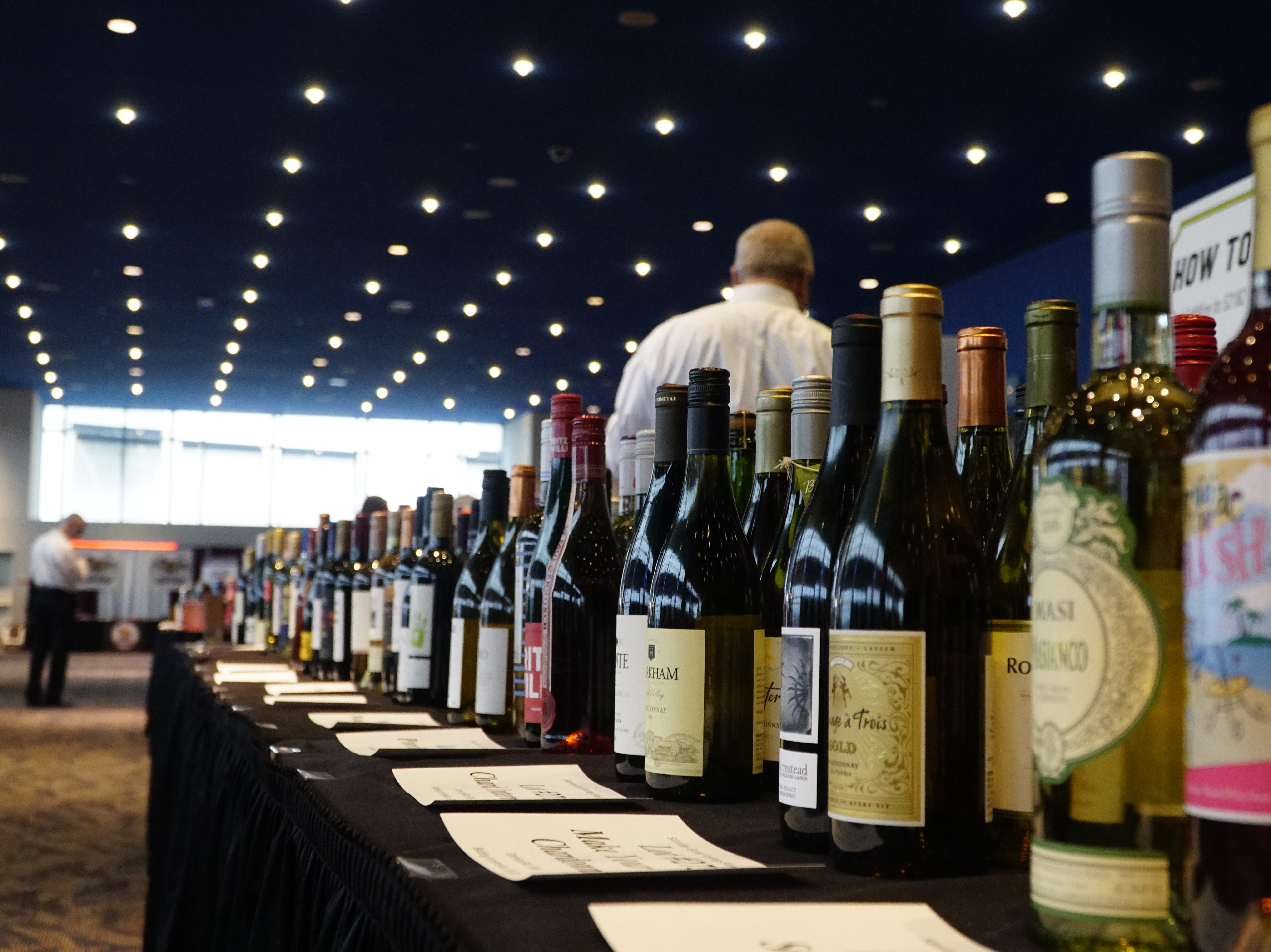 Collections of wine wait to be auctioned at The Cincinnati International Wine Festival, March 9, 2019.