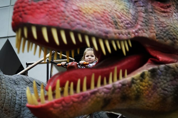 Mable Young , age three, grew increasingly uncomfortable as she rode a dinosaur at Jurassic Quest, March 9, 2019.