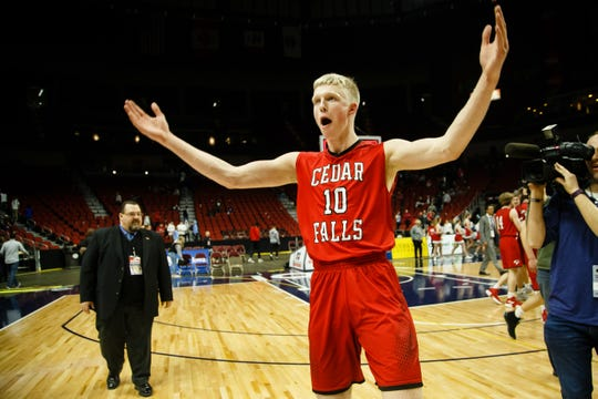 Cedar Fall's Logan Wolf (10) celebrates their 44-41 victory over Dubuque Senior during their boys 4A state basketball championship game on Friday, March 8, 2019 in Des Moines.