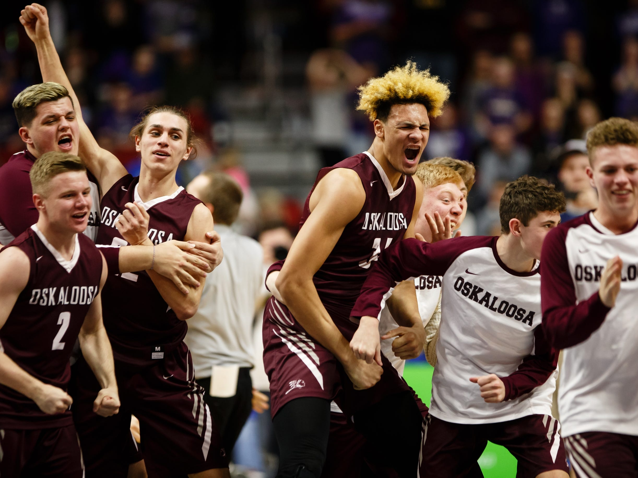 Oskaloosa celebrates its 48-44 win over Norwalk to win the boys 3A state basketball championship game on Friday, March 8, 2019 in Des Moines.