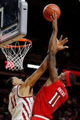 Texas Tech forward Tariq Owens is fouled by Iowa State guard Talen Horton-Tucker, left, while driving to the basket during the second half of an NCAA college basketball game, Saturday, March 9, 2019, in Ames, Iowa. Texas Tech won 80-73.