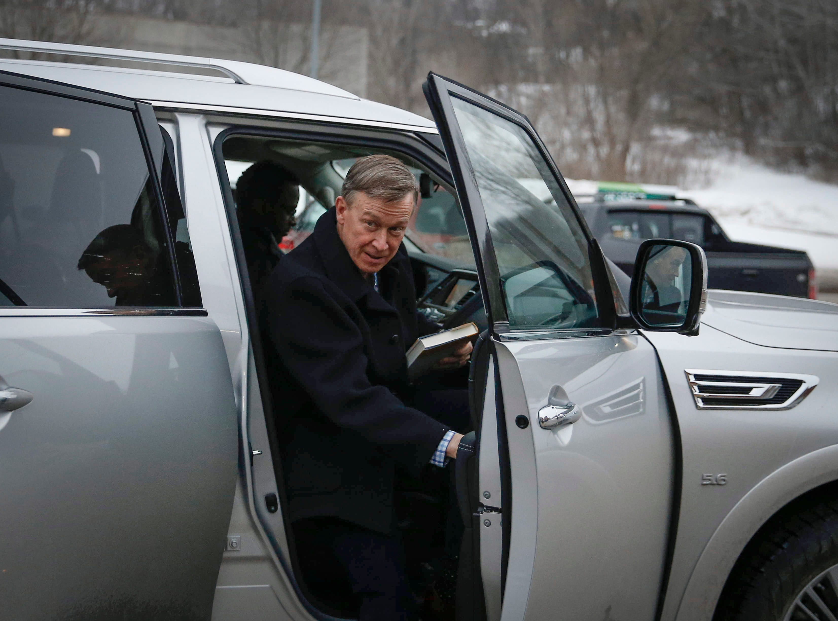 John Hickenlooper, former Colorado governor and current Democratic presidential candidate hopeful, exits his vehicle tp speak to supporters on Friday, March 8, 2019, at Confluence Brewery in Des Moines.
