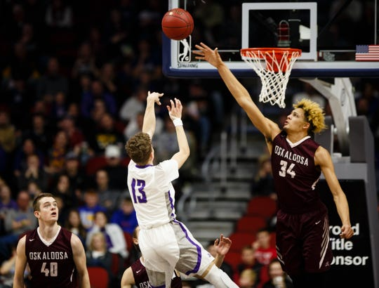Norwalk's Bowen Born (13) shoots over Oskaloosa's Xavier Foster (34) during their boys 3A state basketball championship game on Friday, March 8, 2019 in Des Moines. Norwalk leads Oskaloosa at halftime 31-30.