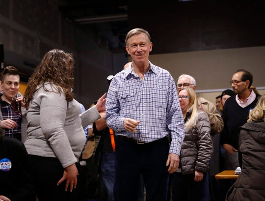 John Hickenlooper, former Colorado governor and current Democratic presidential candidate hopeful, is greeted by supporters upon entering Confluence Brewery in Des Moines during a campaign stop on Friday, March 8, 2019.