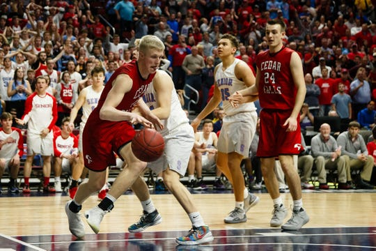 Cedar Fall's Logan Wolf (10) drives to the net during their boys 4A state basketball championship game on Friday, March 8, 2019 in Des Moines. Cedar Falls would go on to defeat Dubuque Senior 44-41 and win the 4A state championship.