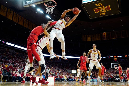 Iowa State guard Lindell Wigginton (5) grabs a rebound over Texas Tech center Norense Odiase, left, during the first half of an NCAA college basketball game, Saturday, March 9, 2019, in Ames, Iowa.