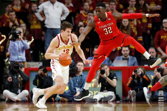 Iowa State forward Michael Jacobson drives past Texas Tech center Norense Odiase (32) during the first half of an NCAA college basketball game, Saturday, March 9, 2019, in Ames, Iowa.
