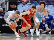 Drake's Brady Ellingson (left) and Illinois State's Matt Hein reach for the ball as Drake's Noah Thomas (right) watches during the first half of the Missouri Valley Conference Tournament quarterfinals in St. Louis.