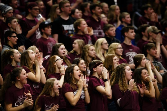 The North Linn cheering section cheers during their boys 2A state basketball championship game on Friday, March 8, 2019, in Des Moines. North Linn would go on to defeat Boyden-Hull 60-41 and win the 2A championship.