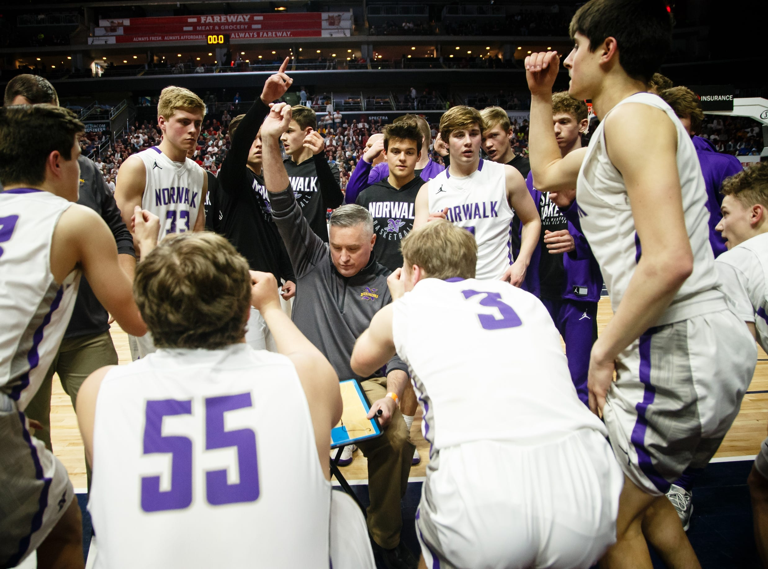 Norwalk head coach Chris Larson brings his team together during their boys 3A state basketball championship game on Friday, March 8, 2019 in Des Moines. Oskaloosa would go on to defeat Norwalk 48-44 to win the 3A championship.