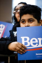 People watch as Democratic presidential candidate Bernie Sanders speaks during a rally at the Iowa State Fairgrounds on Saturday, March 9, 2019 in Des Moines.