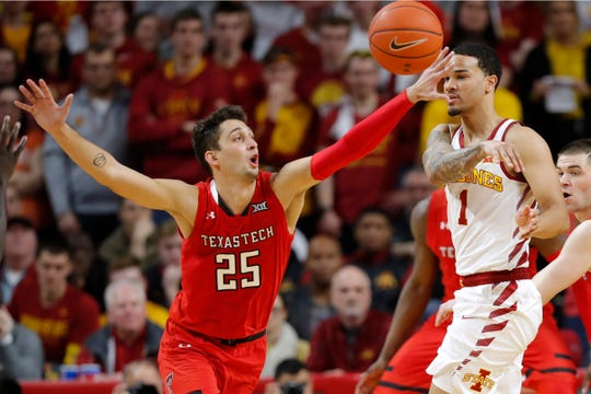 Texas Tech guard Davide Moretti (25) tries to steal the ball from Iowa State guard Nick Weiler-Babb during the second half of an NCAA college basketball game, Saturday, March 9, 2019, in Ames, Iowa. Texas Tech won 80-73.